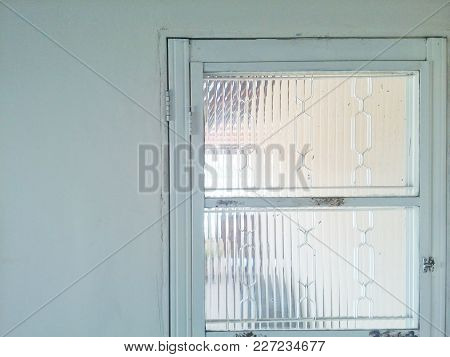 Simple Glass Window Inside House Allowing Light To Enter The House.