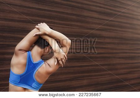 Fitness Woman Stretching Her Back Before Running Outdoors, Back View. Young Slim Girl Makes Aerobics