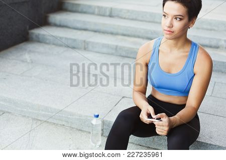 Tired Runner Breathing, Taking Run Break, Sitting On Staircase. Athlete Woman Having Rest After Work