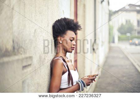 Stylish girl using a smartphone