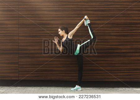 Fitness, Woman Training Yoga In Std Bow Pose At Wooden Wall Background, Copy Space. Young Slim Girl