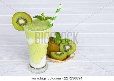 Kiwi Yogurt Smoothies Juice And Kiwi Fruit For Breakfast In The Morning  On White Wood.