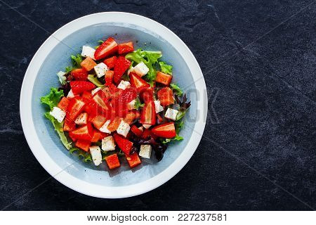 Summer Watermelon Salad With Arugula, Feta Cheese And Fresh Strawberry On Wooden Background. Flat La