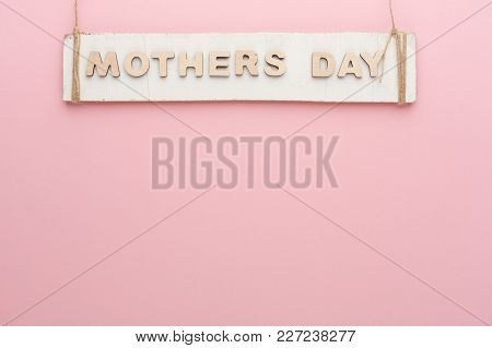 Mothers Day Background. Rustic Wooden Plank And Letters Hanging On Twine At Tender Pink Backdrop, Co