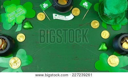 St Patrick's Day Leprechaun Hat With Decorations On Green Rustic Background.