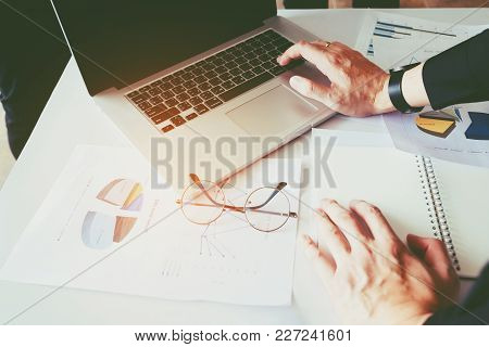 Business Man Using Laptop With Report Chart In Office Planning New Business Project