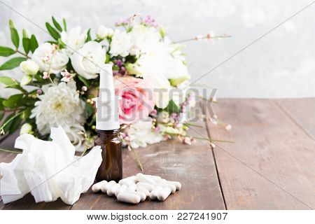 Seasonal Allergy Concept With Spray, Pills And Wrinkled Tissue On Wooden Table With Copy Space
