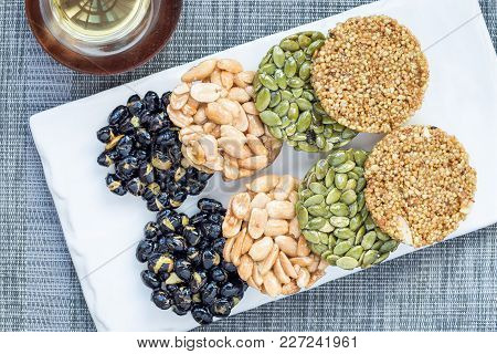Korean Traditional Sweet Snacks With Peanuts, Pumpkin Seeds, Black Soybeans And Chinese Buckwheat. H