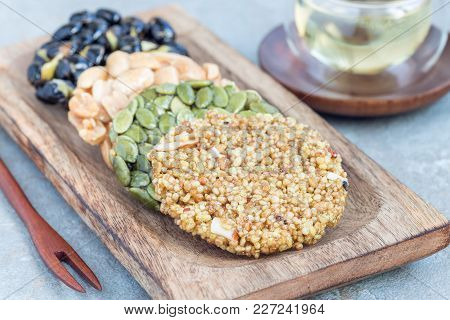 Korean Traditional Sweet Snacks With Peanuts, Pumpkin Seeds, Black Soybeans And Chinese Buckwheat On