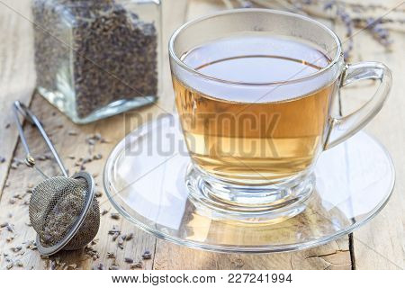 Healthy Herbal Lavender Tea In A Glass Cup With Lavender Flowers On Background, Horizontal
