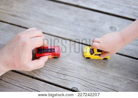 Father With His Little Son Playing With Toy Cars. Fatherhood And Childhood Concept