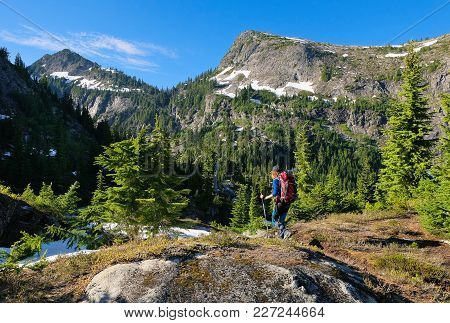 A Woman Hiker Among Stunning Peaks And Forest. North Cascades National Park, Washington