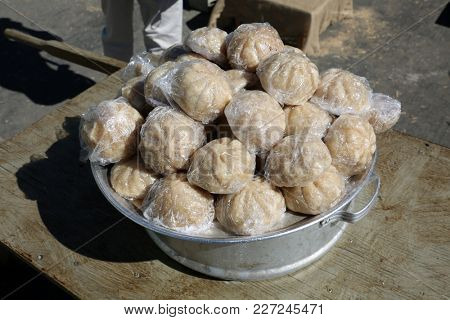 Steamed Pork Buns. Traditional Pork Buns wrapped in plastic wrap.