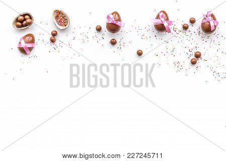 Chocolate Easter Eggs As Little Gift. White Background Top View.