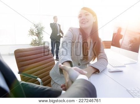 business people shaking hands with each other.