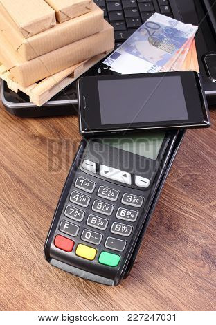 Credit Card Reader With Mobile Phone With Nfc Technology, Currencies Euro, Laptop And Small Wrapped