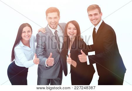 happy business team showing thumb up.i