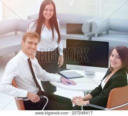 portrait of successful business team near the desktop