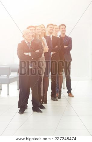 professional team confidently look forward, standing in the midd