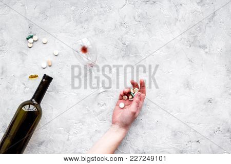 Hungover Syndrome. Alcoholism. Glass And Pills On Grey Background Top View.