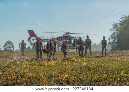 Nakhon Ratchasima, Thailand - December 23, 2017: Rescue Team Carrying Injured Paasenger To Helicopte