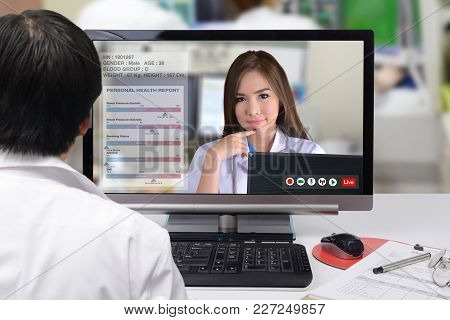 Two Doctors Are Discussed On Patient Medication By Distance Communication Technology.