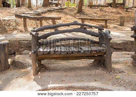 An Old Wooden Bench In The Garden In The Summer Season.