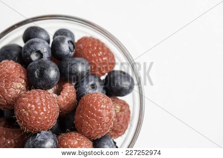 Mixed Berries With Blueberries And Raspberries On A White Background