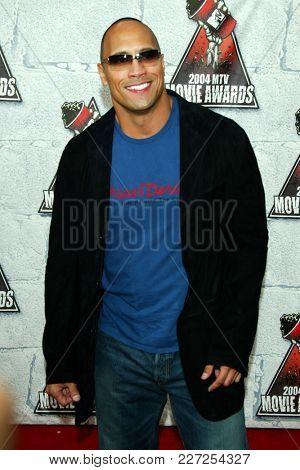 LOS ANGELES - JUN 05:  Dwayne Johnson arrives to the Mtv Movie Awards  on June 5, 2004 in Culver City, CA.