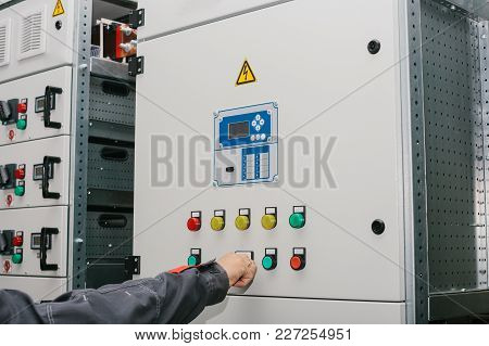Photo Of Male Electrical Technician Specialist Checking Indoor Electric Low-voltage Cabinet Equipmen