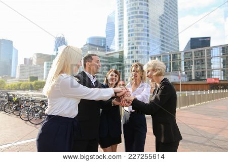 Prosperous Business Team Rejoicing Good Result And Greeting Each Other Outdoors In  . Concept Of Enj