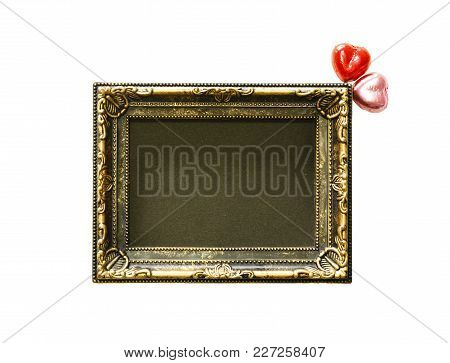 Valentines Day Background With Red And Pink Chocolates Heart Shape And Gold Frame From Top View. Cop