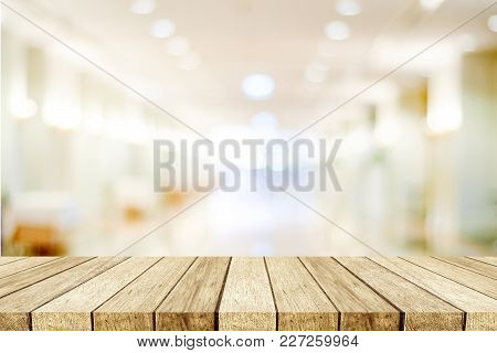 Perspective Wood, Table, Shellf, And Blurred Store With Bokeh Background, Product Display Montage
