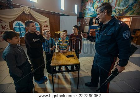 NIKOLSKY, RUSSIA - JAN 19, 2018: Training of children to use weapons in the framework of revival program of the Cossacks in the Leningrad region. Cossacks in St.Petersburg began its revival in 1990.