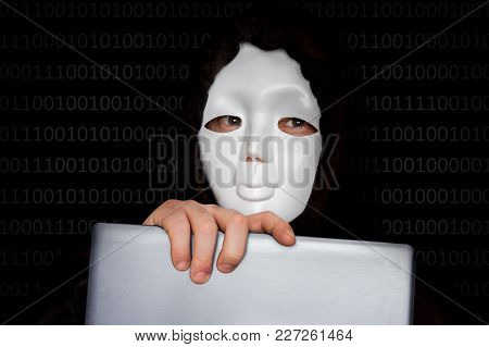 Portrait Of Anonymous Man With White Mask Isolated On Black Background