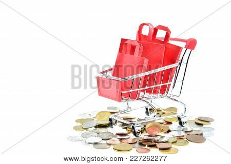 Shopping Bags In Cart On White Background. The Inside Shopping Cart Has Red Shopping Bags With  Silv