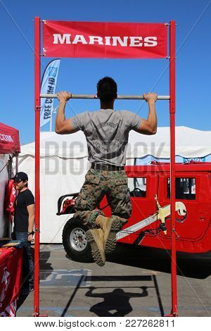 Costa Mesa CA. 2-17-2018 Marine demonstrating how to do a pull up the correct way at the 2018 Tet Festival in Costa Mesa California