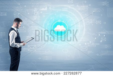 Standing businessman with data around and highlighted icon on the centre