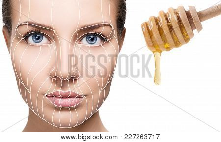 Female Face With Lifting Lines Near Flows Down Honey. Graphic Lines Showing Facial Lifting Effect On