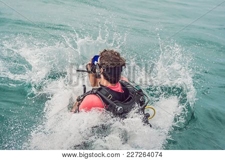 Divers Jump In The Sea To Start Diving.