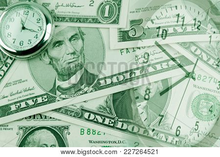 Clocks on assorted American banknotes. Time is money idea