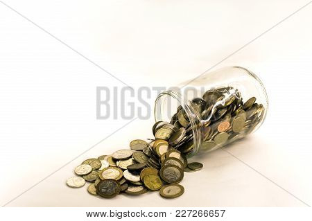 Coin Money In Glass Jar, White Background In Different Positions