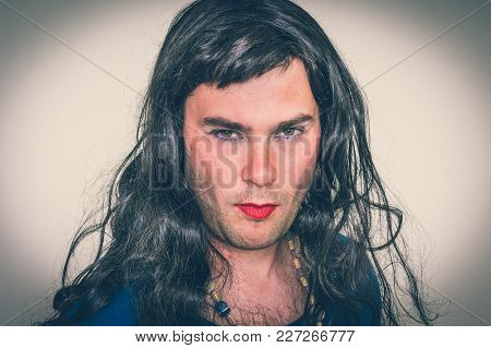 Bearded Man Wearing Makeup And Blue Female Dress - Retro Style