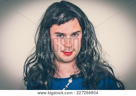 Attractive Man Wearing Makeup And Blue Dress Looks Like As A Woman - Retro Style