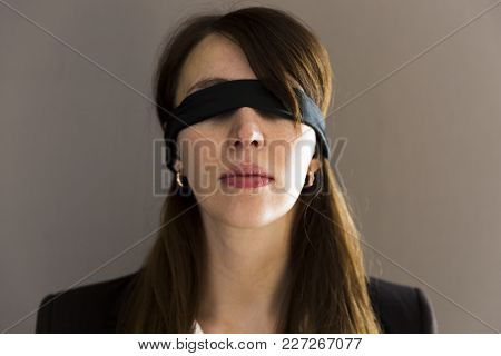 Blind Young Businesswoman On Grey Background In Natural Light
