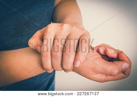 Woman With Wrist Pain Is Holding Her Aching Hand - Body Pain Concept - Retro Style
