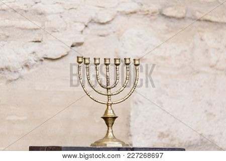 Cordoba, Spain - April 12, 2017: The Menorah, The Seven-lamp Ancient Hebrew Lampstand In The Synagog