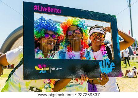 Johanneburg, South Africa,  09/25/2016, Three African Girls Having Fun At The Color Run 5km Marathon