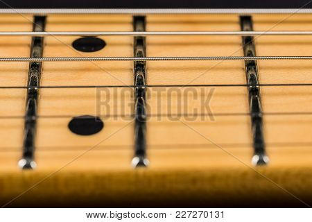 Close Up Of An Electric Guitar Fretboard