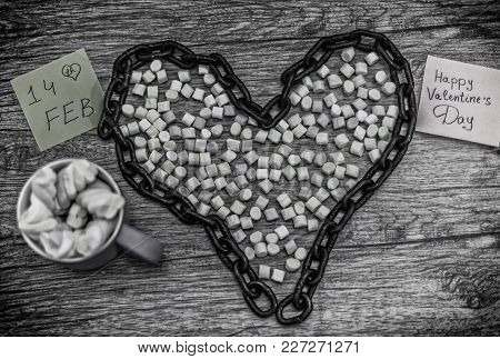Cup And Chain Shape Of Heart With The Word 14th February